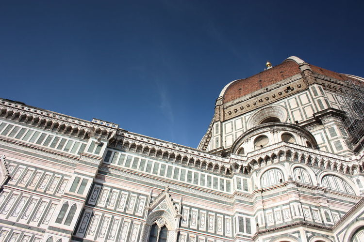 Side facade and details of the cathedral of the famous cathedral of florence in italy
