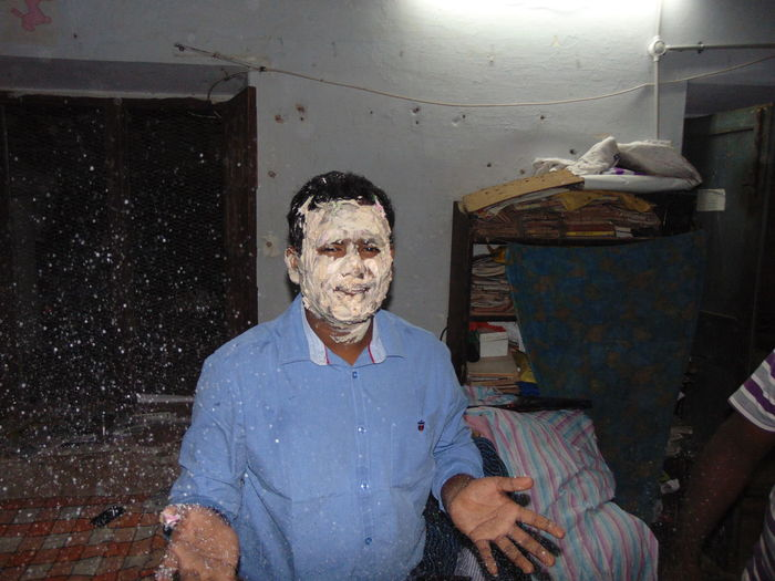 Portrait Of Man Covered In Cream Celebrating At Home