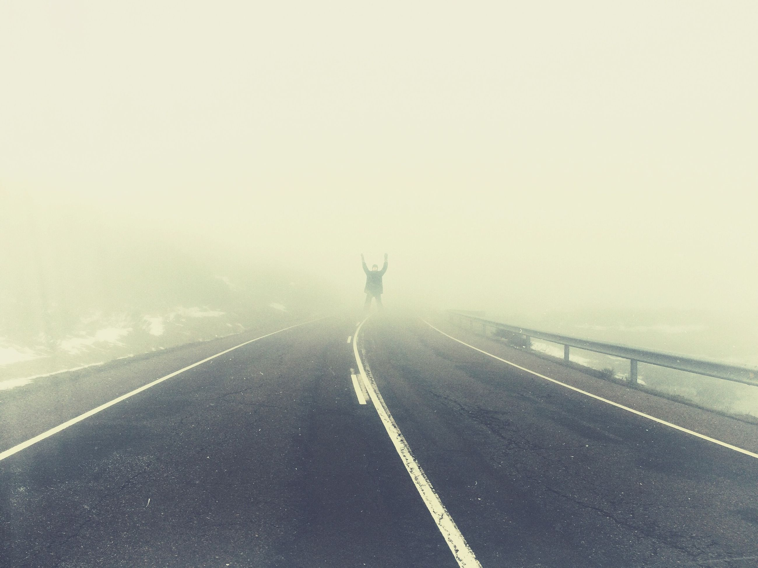 the way forward, transportation, road, road marking, diminishing perspective, vanishing point, copy space, fog, rear view, country road, walking, asphalt, full length, sky, on the move, long, day