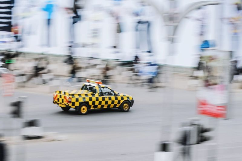 Camouflage Streetphotography Street Yellow Checked Pattern Blackandyellow Panning Nairobi Africa Kenya Urban Mobility In Mega Cities Blurred Motion Speed Motion Car City Street Transportation City
