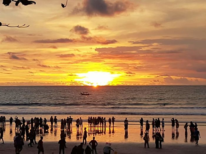 Sunset, kuta beach. Silhouette