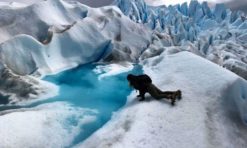 Winter Women Lake Effort Water Trekking Patagonia Glacier Perito Moreno. Patagonia. Argentina. Adventure Ice Extreme Sports Ice Trekking Crampons Cold Temperature Winter Snow Water One Animal Frozen Nature Ice Day Beauty In Nature One Person