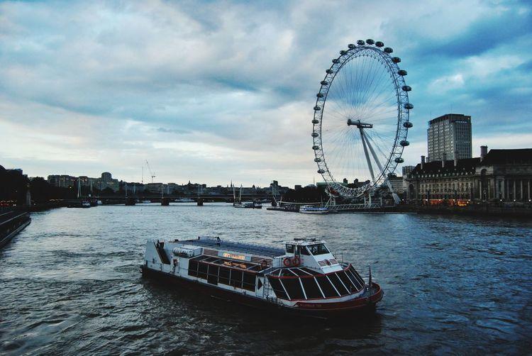 View of ferris wheel in city