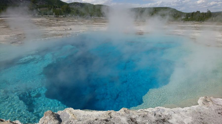 EyeEm Selects Hot Spring Water Gas Fumes Steam Heat - Temperature Smoking - Activity Erupting Blue Volcanic Crater Geology Natural Landmark Natural Phenomenon Geyser