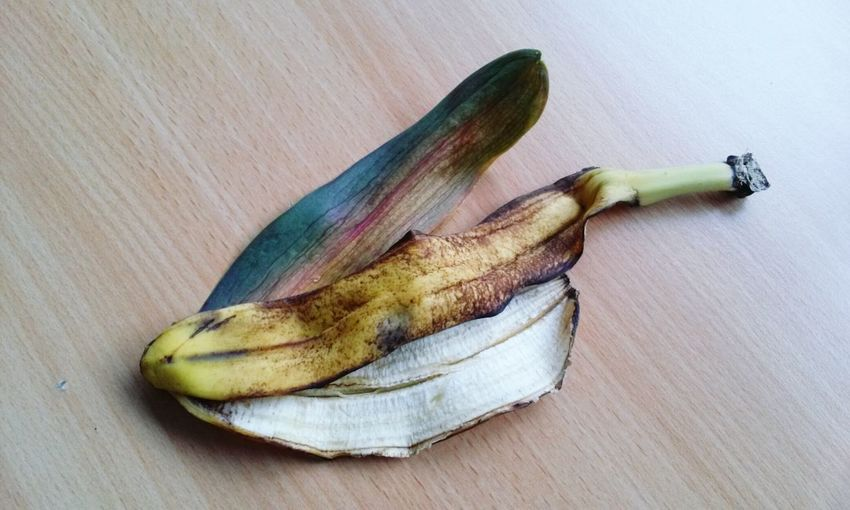 High Angle View Of Banana Peel On Wooden Table