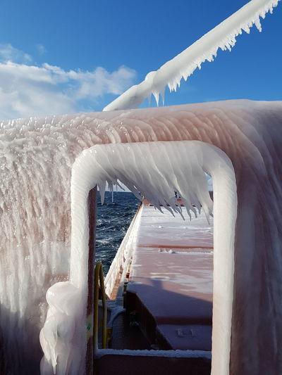 Frozen boat against sky
