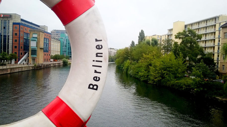 Berlin Riverside Sign Spree Architecture Berliner Ansichten Building Exterior Built Structure City Cityscape Day Germany Nautical Vessel No People Outdoors River Tree Water