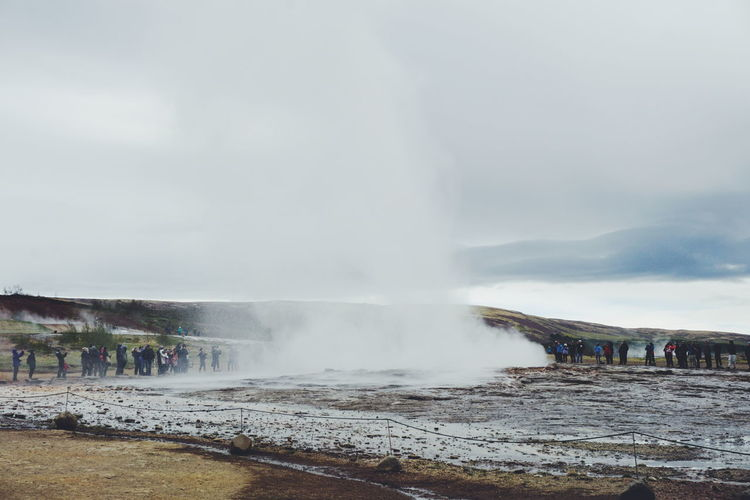 Geyser in Iceland Beauty In Nature Day Erupting Geyser Heat - Temperature Hot Spring Iceland Icelandic_explorer Incidental People Large Group Of People Motion Nature Outdoors People Physical Geography Power In Nature Real People Scenics Sky Smoke - Physical Structure Steam Tourism Travel Travel Destinations Water The Great Outdoors - 2017 EyeEm Awards Lost In The Landscape