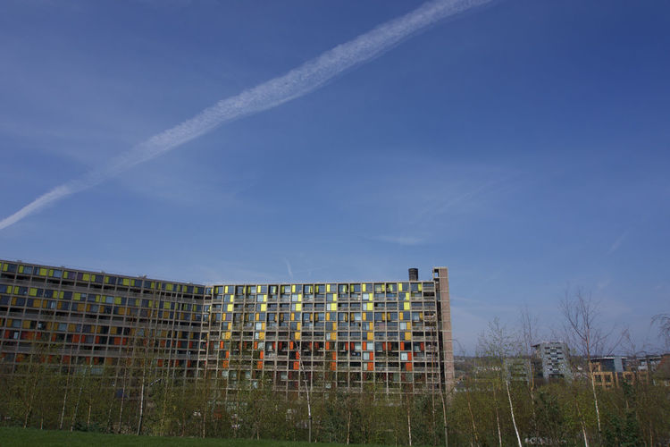Renovated buildings at Park Hill, Sheffield under blue sky Sheffield Park Hill Architecture Sky Built Structure Building Exterior Building Nature Day No People Outdoors Blue Apartment Plant Cloud - Sky Vapor Trail Grass Tree Low Angle View Copy Space Landscape Industry