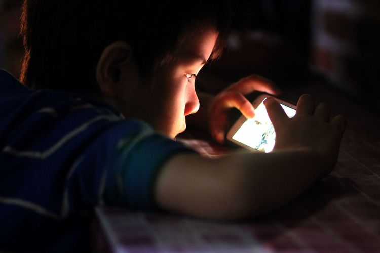 Mobile Phone Gaming Night Real People Portrait Boys Child Glowing Illuminated Concentration Childhood Dark Games Technology Playing Games On IPhone Digital Native Headshot Communication Side View Connection Mobile Phone Holding Lifestyles Wireless Technology Domestic Room