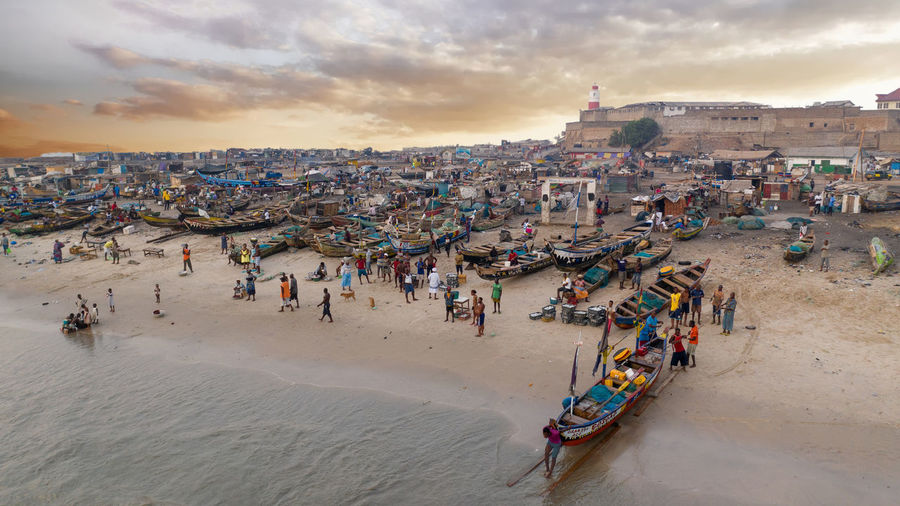 High angle view of people at beach against sky
