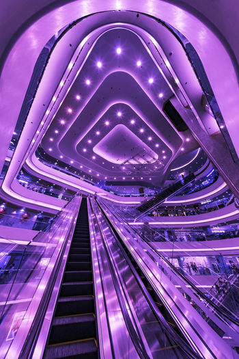 Cyberpunk Neon Colored Mall Time Square Hong Kong SiFi Interior Design EyeEm Best Shots EyeEm Gallery EyeEm Selects Illuminated Architecture Built Structure Connection Transportation Purple Indoors  No People Travel Destinations Bridge Pink Color Travel Direction Metal City Arch Bridge - Man Made Structure Lighting Equipment Diminishing Perspective Night Light
