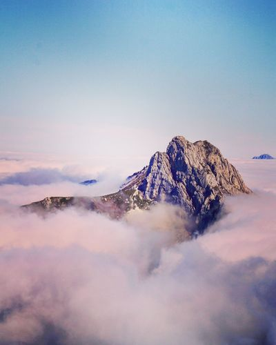 Mountain and cloudscape against sky