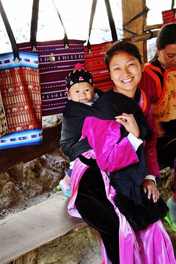 Hmong Tribeswoman and Child Hmong Hmongtribe Thailand Child Females Real People Women Family Portrait Bonding Looking At Camera Innocence Smiling Moments Of Happiness