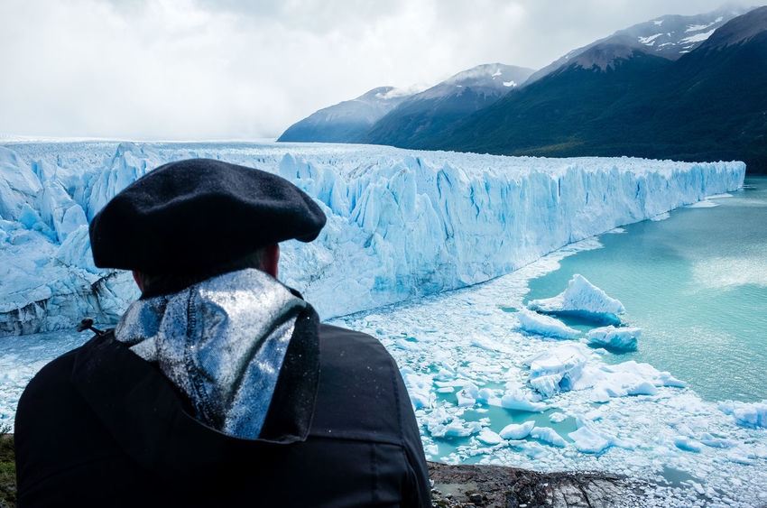 Perito Moreno, 2018 The Traveler - 2018 EyeEm Awards Adult Clothing Cold Temperature Day Environment Hood Hood - Clothing Ice Landscape Leisure Activity Looking At View Men Mountain Nature One Person Outdoors Real People Rear View Sky Snow Snowcapped Mountain Warm Clothing Winter