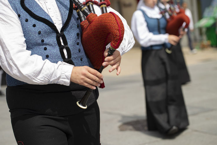 Man playing bagpipe, spanish traditional dance group Asturias Hands Horizontal SPAIN Sunny Traditional Clothing Bagpipe Close Up Clothing Costume Day Folk Folklore Holding Lifestyles Men Music Musical Instrument Outdoors Performance Real People Street Summer Traditional