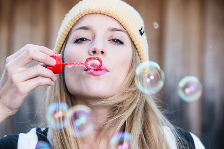 Headshot Portrait One Person Front View Blond Hair Hair Holding Leisure Activity Young Adult Young Women Focus On Foreground Real People Lifestyles Close-up Looking At Camera Bubble Women Blowing Beautiful Woman Hairstyle