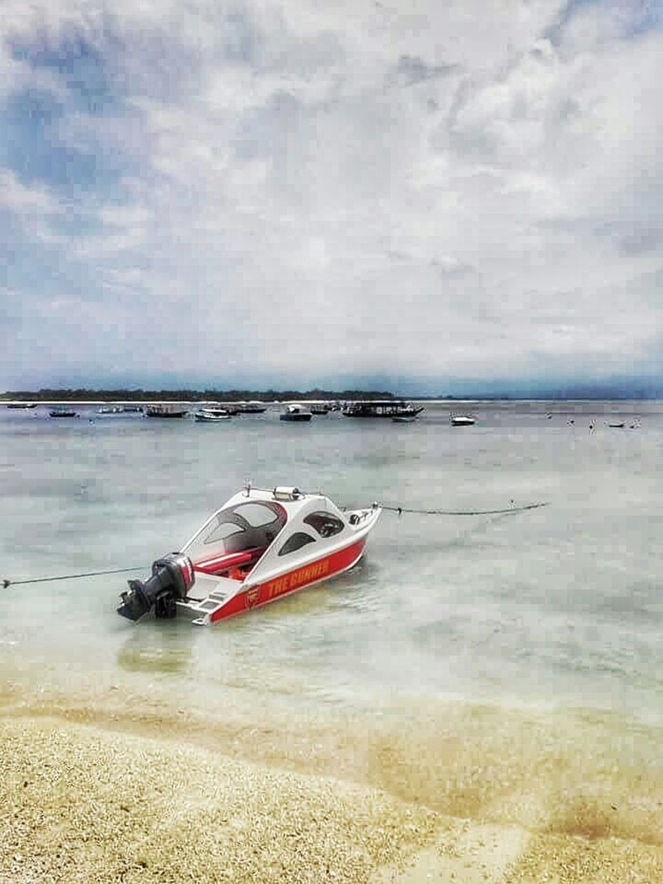 water, sea, beach, cloud - sky, transportation, nautical vessel, outdoors, sky, day, nature, horizon over water, moored, red, sport, no people, jet boat