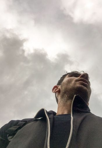 Cloud - Sky One Person Low Angle View Headshot Sky Lifestyles Visual Creativity Real People Men Outdoors Young Adult Looking Away Leisure Activity Nature