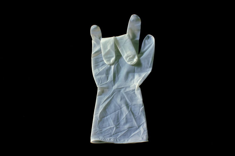 Close up of surgical glove on black background