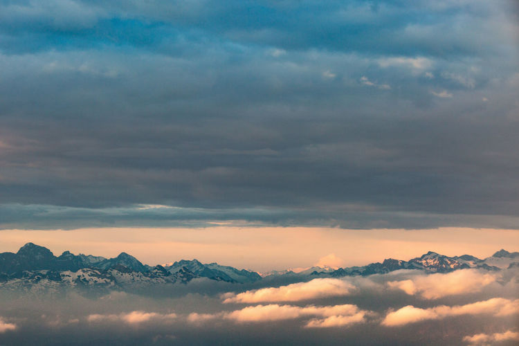 Morning clouds parting ways and the swiss alps temporary came into view - zurich, switzerland