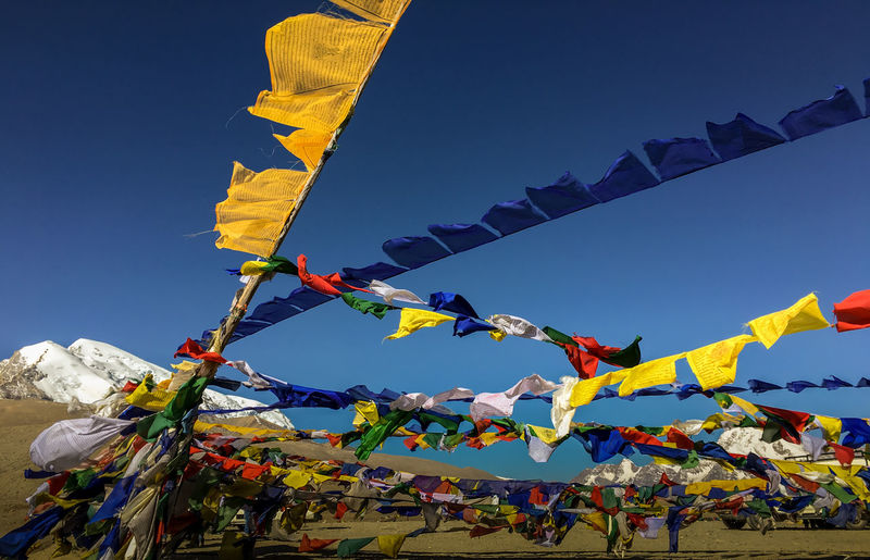 Praying flags hanging against sky
