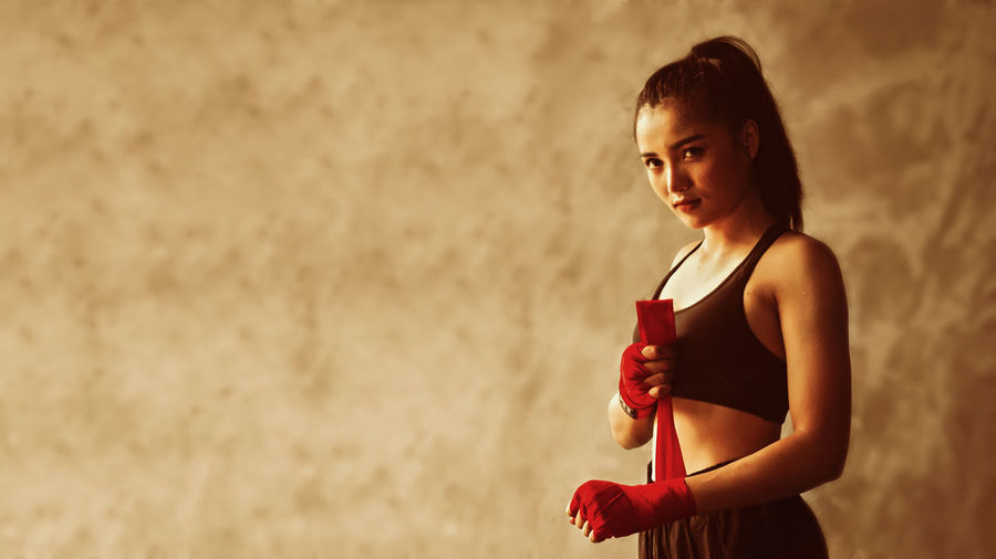 healthy,beautiful,body,boxer,boxing,calorie,care,champion,coach,competition,concept,confidence,confident,defense,energy,exercise,female,fight,fighter,fit,fitness,girl,gloves,gym,health,human,kickboxing,lifestyle,martial,modern,muscular,portrait,power,pretty,sexy,shape,sport,sportsmen,strength,strong,success,sweat,sweating,training,victory,vitality,wellness,winner,women,yoga Portrait Women Lifestyles Boxer Calories Champion Winner Beauty Strong,black Independent Young Lady