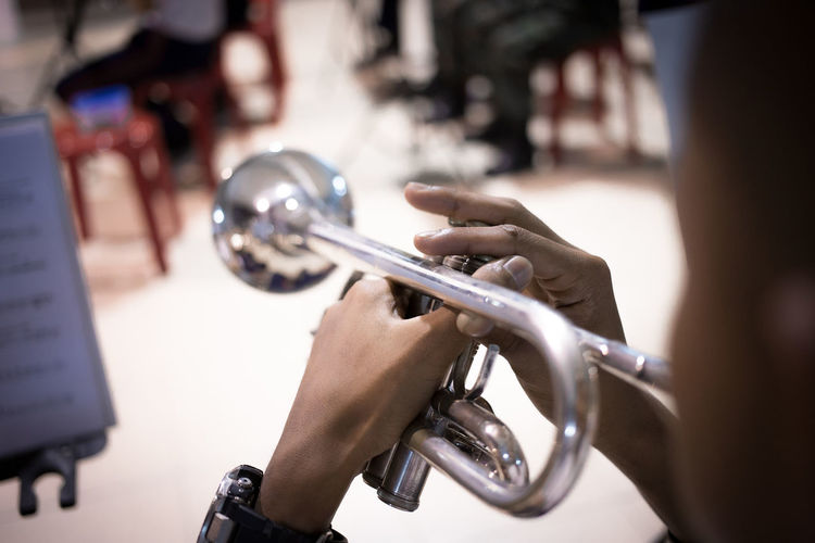 Artist Brass Instrument  Finger Holding Human Body Part Human Hand Music Musical Instrument Musician Orchestra Playing Skill  Trumpet