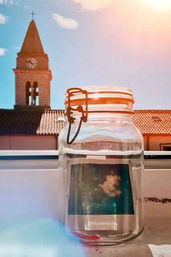 Summer in the jar Sky No People Day Summer Sunlight Sun Jar Polaroid Window Cloud Church Lens Flare