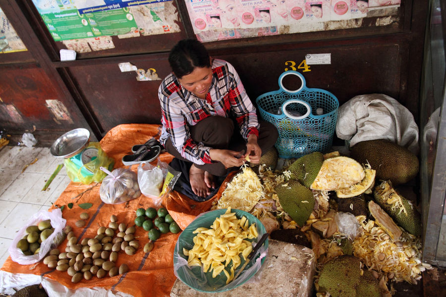 Abundance Battambang Cambodia Food Food And Drink For Sale Freshness Fruits Indoors  Jackfruit Large Group Of Objects Market Market Stall One Person Retail  Woman Woman Selling