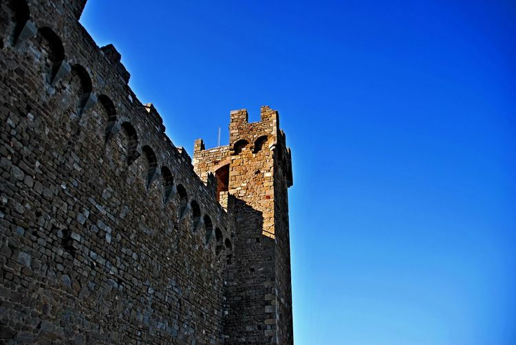 Montalcino. Ancient Ancient Civilization Architecture Blue Building Exterior Built Structure Castle Clear Sky Day Fort History Low Angle View Medieval No People Old Ruin Outdoors Protection Royalty Sky Travel Destinations