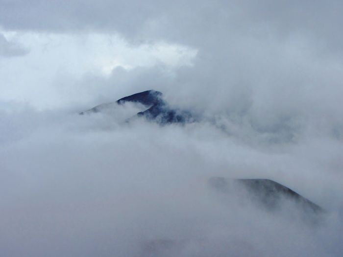 In the clouds at Haleakalā Crater, Maui, Hawaii. Hawaii Beauty In Nature Cloud - Sky Covering Day Environment Foggy Geology Landscape Mountain Mountain Peak Nature No People Non-urban Scene Outdoors Scenics - Nature Sky Tranquil Scene Tranquility Volcano Water Go Higher