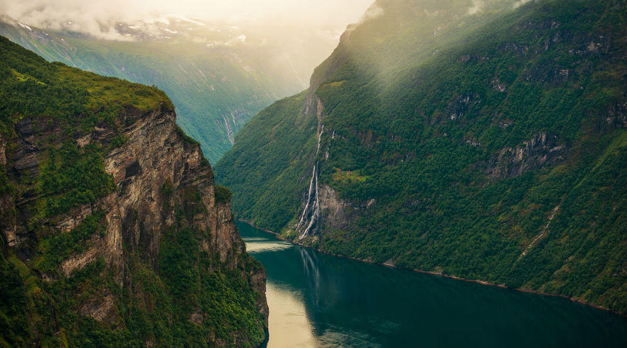 Scenic view of river amidst mountains