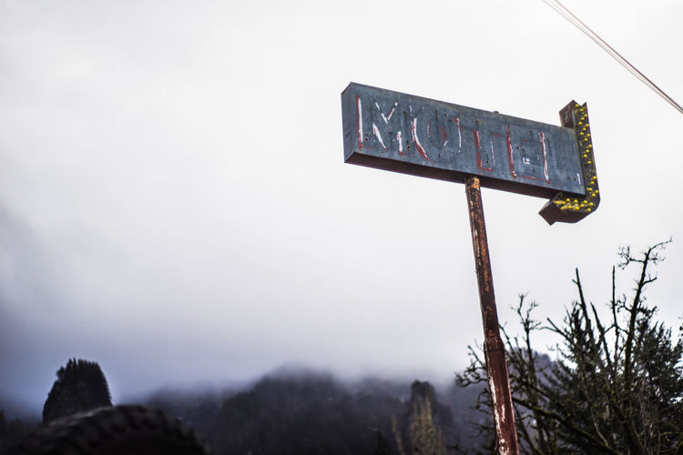 Close-up Day Low Angle View Motel Mountain Nature No People Outdoors Signboard Sky Text Vintage