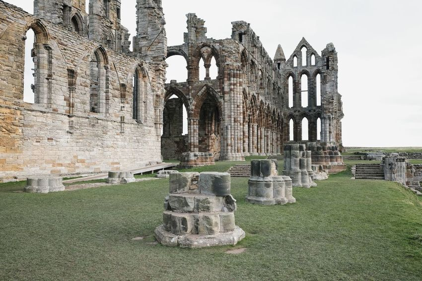 Abbey Ancient Ancient Civilization Architecture Belief Building Building Exterior Built Structure Day Grass History Nature No People Old Ruin Outdoors Place Of Worship Religion Ruined Sky Spirituality Stone Material The Past Tourism Travel Travel Destinations