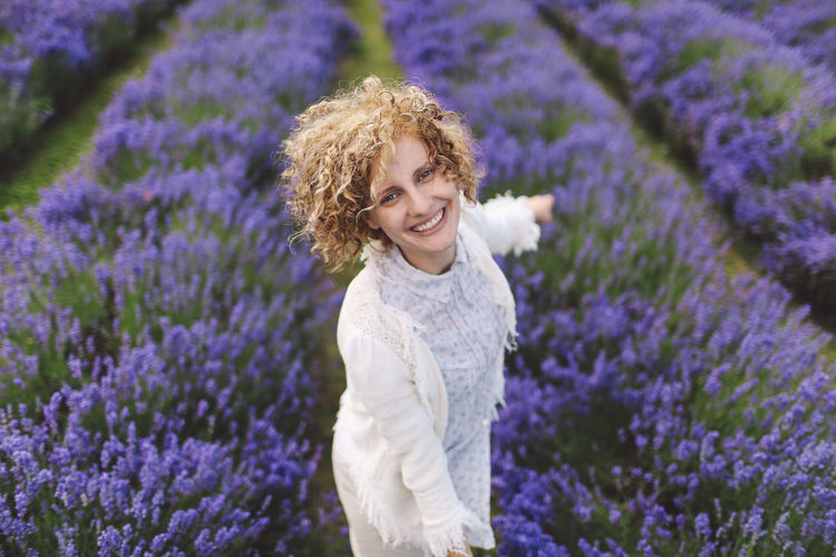 Portrait of woman enjoying on lavender field
