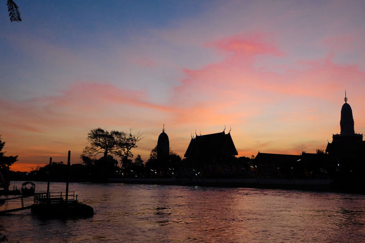 Sunrise at Ayutthaya world heritage city Thaialand Sunset Silhouette Architecture Water Reflection Sky Outdoors Tranquility Built Structure Travel Destinations No People Building Exterior Day Thailand🇹🇭 Beauty In Nature Thailand Trip Sunrise_sunsets_aroundworld Sunrise_Collection Rivers