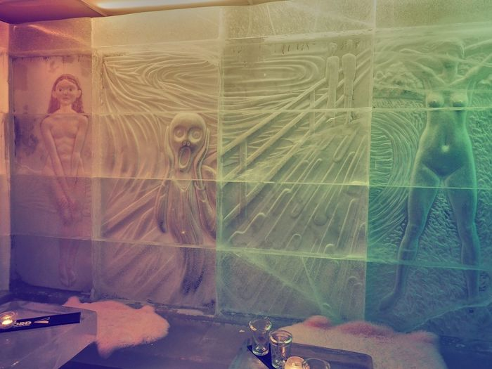 Digital composite image of man photographing through glass window