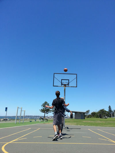 Australia Basketball Basketball Hoop Beach Life EyeEm Best Shots Hoop Athlete Basketball - Sport Basketball Hoop Basketball Player Blue Blue Sky Clear Sky Competitive Sport Copy Space Day Full Length Lifestyles Men Outdoors Playing Real People Sport Sports Clothing Training Summer Sports