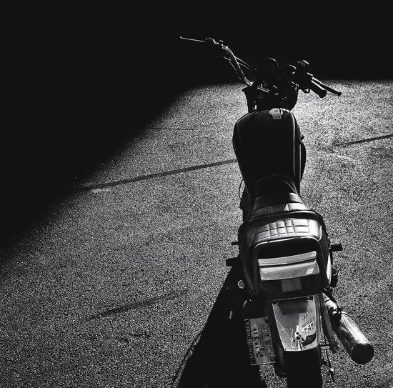 Shadow of bicycle on motorcycle
