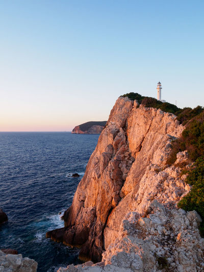 Sunset at Cape Lefkas lighthouse, Lefkada, Greece Architecture Beauty In Nature Building Exterior Built Structure Clear Sky Cliff Day Greece Guidance Horizon Over Water Lefkada Lighthouse Nature No People Outdoors Scenics Sea Sky Sunset Tranquil Scene Tranquility Travel Destinations Water