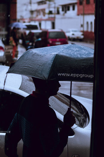 The URL Umbrella Streetphotographer Cloud - Sky One Person EyeEm Selects Streetphotography City Street EyeemTeam EyeEm Team The Week On Eye Em Street Photography Outdoors Umbrellas EyeEm Umbrellastreet