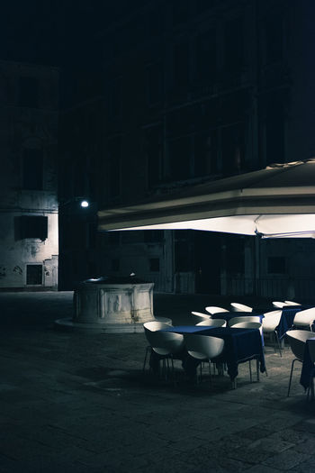Absence Architecture Building Building Exterior Built Structure Business Chair City Empty Illuminated In A Row Lighting Equipment Nature Night No People Outdoors Restaurant Seat Street Table Venice
