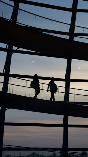 Adult Airport Building Colleagues Conversation Curve Day Discussion Friendship Glass Low Angle View Men Modern Architecture Modern Building Only Men People Person Ramp Silhouette Silhouette Silhouettes Sky Togetherness Travel Two People