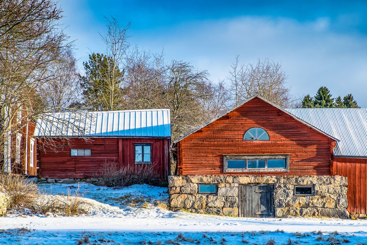 Agricultural Building Architecture Bare Tree Barn Blue Building Exterior Built Structure Cold Temperature Cottage Day Finland House Log Cabin Nature No People Outdoors Residential Building Sky Snow Tree Winter Wood - Material