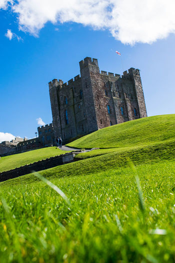 Bamburgh Castle Architecture Building Exterior Built Structure Castle Clear Sky Cute Day Follow Grass Green Color Happy History Landscape Like Nature No People Outdoors Photography Photooftheday Picoftheday Pleasecomment Pleasefollow Pleaselike Sky Travel Destinations