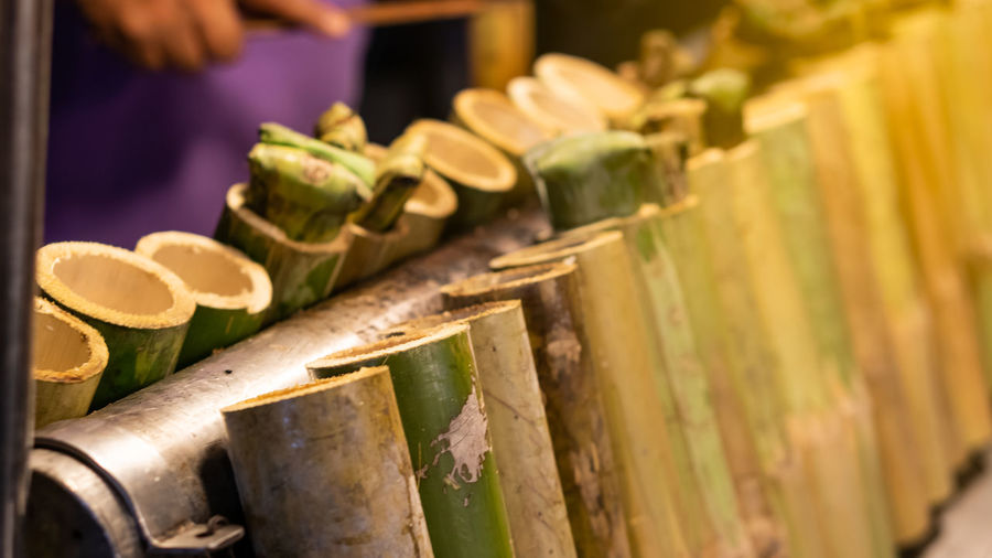 Khao Lam That Put Rice In Wooden Barrels Sold At The Event Indoors  Close-up Bamboo - Material One Person In A Row Musical Instrument Midsection Business Occupation Day Arts Culture And Entertainment Focus On Foreground Selective Focus Wood - Material Musical Equipment Real People Incidental People Food,rice,nature,green,sticky,background,tube,bamboo,cooked,natural,wood,fire,thailand,wall,until,shell,blue,texture,old,burn,plant,garden,travel,landscape,paint,vivid,red,design,row,nobody,art,equipment,brown,group,dirty,color,material,closeup,wooden,pai