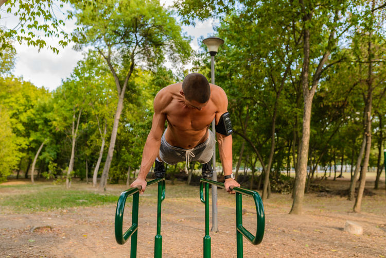Adult Adults Only Athlete Beautiful People Beauty Beauty In Nature Building - Activity Concentration Day Exercising Gym Handsome Healthy Lifestyle Incentive Jogging Lifestyles Males  Masculinity Men Motivation Muscular Build One Man Only One Person One Young Man Only Only Men Outdoors Park People Photography Practicing Relaxation Relaxation Exercise Sport Sports Clothing Sports Shoe Sports Training Sportsperson Strength Success Sun Sunlight The Human Body Training Class Vertical Vitality Workout Young Adult