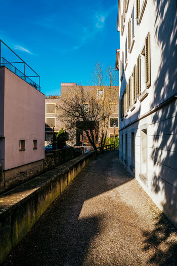Alley amidst buildings during sunny day