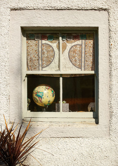 World in a window Architecture Built Structure Window Building Exterior No People Building Day Wall - Building Feature Outdoors Glass - Material Nature Transparent Plant Sphere Wall Globe Shape House Design Art And Craft